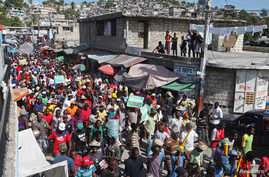 Demonstrators march through the streets during an anti-government protest in Port-au-Prince, December 5, 2014.