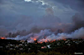 A wildfire rages in the town of Rafina, near Athens, Greece