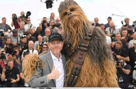 Director Ron Howard, from left, and a person wearing a costume of the character Chewbacca pose for photographers during a photo call for the film 'Solo: A Star Wars Story' at the 71st international film festival, Cannes, southern France, May 15, 2018