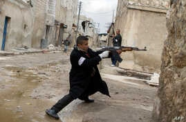A Syrian rebel aims his weapon during clashes with government forces near Aleppo international airport, March 4, 2013.