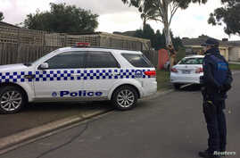 FILE - Australian police search what is believed to be the home of gunman Yacqub Khayre, who was shot dead by police on Monday after he shot a man dead and held a woman hostage, in the Melbourne suburb of Roxburgh Park in Australia, June 6, 2017.