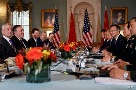Secretary of Defense Jim Mattis (L) Secretary of State Mike Pompeo (2nd-L), Chinese Politburo Member Yang Jiechi (3rd-R), and Chinese State Councilor and Defense Minister General Wei Fenghe (2nd-R) meet at the State Department in Washington, Nov. 9,