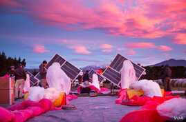 Project Loon technicians prepare the first pilot test in New Zealand in 2013.