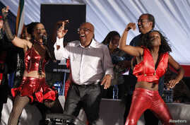 South Africa's Minister of Health, Aaron Motsoaledi (C), dances during the launch of a major HIV counseling and testing campaign at Katlehong township outside Johannesburg, April 25, 2010.