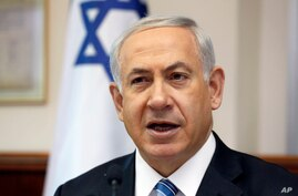 FILE - Israeli Prime Minister Benjamin Netanyahu chairs the weekly cabinet meeting in his office in Jerusalem.