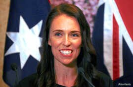 FILE - New Zealand Prime Minister Jacinda Ardern smiles as she answers a question during a media conference in Sydney, Australia, Nov. 5, 2017.