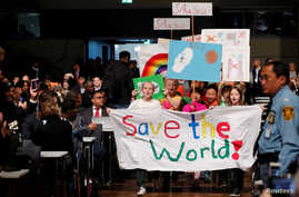 Children are seen during climate march prior to the opening session of the COP23 U.N. Climate Change Conference 2017, hosted by Fiji but held in Bonn, in World Conference Center Bonn, Germany, Nov. 6, 2017.