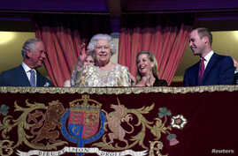 "Britain's Queen Elizabeth waves next to Prince Charles and Prince William, Duke of Cambridge, during a special  ""The Queen's Birthday Party"" concert to celebrate her 92nd birthday at the Royal Albert Hall in London, April 21, 2018."