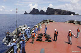 Workers on the city government of Tokyo's survey vessel prepare to survey around a group of disputed islands known as Senkaku in Japan and Diaoyu in China in the East China Sea September 2, 2012. The city government of Tokyo sent a ship to survey a g