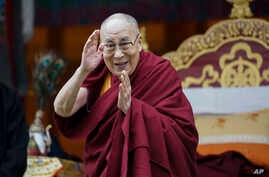 Tibetan spiritual leader the Dalai Lama greets devotees at the Buddha Park in Bomdila, Arunachal Pradesh, India, Wednesday, April 5, 2017.