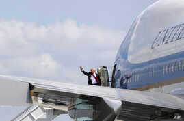 FILE - President Donald Trump waves as he boards Air Force One. Trump arrives in Israel Monday for a two-day visit, following a stop in Saudi Arabia.