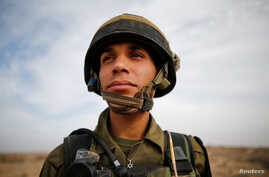 Yussef Saluta, 20, an Israeli Arab soldier from the Desert Reconnaissance battalion takes part in a drill near Kissufim in southern Israel Nov. 29, 2016.