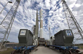 In this undated photo provided by NASA, a United Launch Alliance Atlas V rocket carrying GOES-S, waits for liftoff March 1, 2018, at Cape Canaveral Air Force Station in Florida.