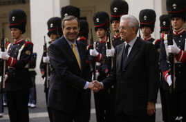 Italian premier Mario Monti, right, shakes hands with Greek Prime Minister Antonis Samaras, at Palazzo Chigi government office, in Rome, September 21, 2012.