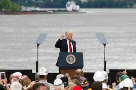 President Donald Trump gestures to the crowd after speaking during a rally at Rivertowne Marina, June 7, 2017, in Cincinnati, Ohio.