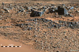 "A color mosaic taken by NASA's Mars Curiosity rover Mast Camera (mastcam) shows strata exposed along the margins of the valleys in the ""Pahrump Hills"" region on Mars in this undated handout photo courtesy of NASA."