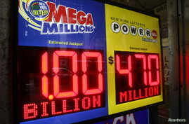 Signs display the jackpots for Mega Millions and Powerball lottery drawings at a newsstands in midtown Manhattan in New York, Oct. 19, 2018.