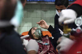 "A Syrian woman receives treatment at a hospital in the regime controlled Aleppo on Nov. 24, 2018. Official Syrian media accused the armed opposition of launching an attack with ""toxic gas"" on the northern city."