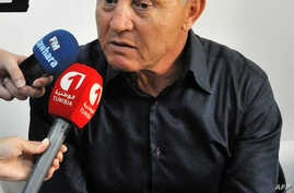 Nida Tunis political party's Ridha Charfeddine answers journalists' questions in the Tunisian coastal city of Sousse, south of Tunis, Oct. 8, 2015.