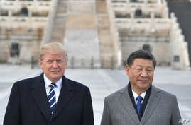 In this file photo taken on Nov. 8, 2017, US President Donald Trump, and Chinese President Xi Jinping pose at the Forbidden City in Beijing.