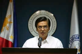 Philippine Department of Foreign Affairs Spokesman Charles Jose delivers a statement about the Philippine protest against China's reclamation of land in a disputed reef in the South China Sea as he faces the media at the Philippine Foreign Affairs he
