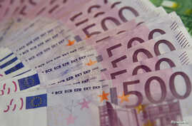 FILE -  A photo illustration shows Euro banknotes, Jan. 26, 2015.