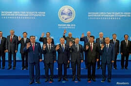 A group photograph of the SCO heads of state, the heads of observer states and governments, and international organization delegation heads during the Shanghai Cooperation Organization (SCO) summit in Ufa, Russia, July 10, 2015.