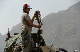 An Afghan border policeman takes position following clashes with Pakistani forces on the border between Afghanistan and Pakistan in eastern Nangarhar province, June 15, 2016.