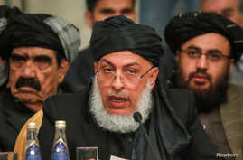 Head of Political Office of the Taliban Sher Mohammad Abbas Stanakzai speaks at a conference arranged by the Afghan diaspora, in Moscow, Russia Feb. 5, 2019.