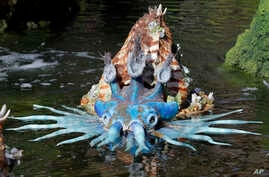 """A water creature floats in a pond at Pandora-World of Avatar land attraction in Disney's Animal Kingdom theme park at Walt Disney World in Lake Buena Vista, Fla. The 12-acre land, inspired by the """"Avatar"""" movie, opens at the end of May."""