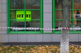 The logo of Russian state-owned television channel RT is seen on a window of the company's office in Moscow, Russia, Oct. 27, 2017.