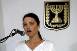 FILE - Ayelet Shaked, Israel's new Justice Minister of the far-right Jewish Home party, speaks during a ceremony at the Justice Ministry in Jerusalem, May 17, 2015.