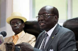 South Sudan's Foreign Minister Barnaba Marial Benjamin speaks during a press conference with Interior minister Aleu Ayienyi Aleu (L), in Juba, South Sudan, April 18, 2014. The Government of South Sudan strongly condemns the attack on innocent civilia