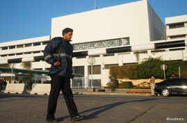 A policeman patrols in front of a parliament building during a session of the national assembly in Islamabad. (File)