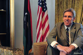 Christopher Stevens, the U.S. ambassador to Libya, smiles at his home in Tripoli June 28, 2012.