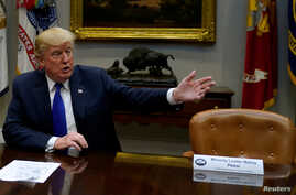 U.S. President Donald Trump, flanked by an empty chair marked for House Minority Leader Nancy Pelosi, who chose not to meet with Trump, Senate Majority Leader Mitch McConnell and House Speaker Paul Ryan, at the White House in Washington, Nov. 28, 201