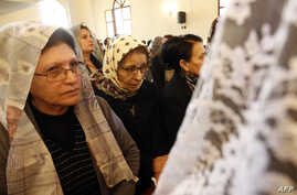 Assyrian Christians, who had fled the unrest in Syria, attend a mass at the Saint Georges Assyrian Church in Jdeideh, northeast of the Lebanese capital Beirut during the Good Friday procession, April 3, 2015.