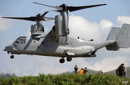FILE - A US Air Force V-22 Osprey prepares to land near the command post prior to live fire drills on the last day of the annual US-Philippine joint military exercise at the former US traget range in Crow Valley, Capas town, north of Manila on May 15