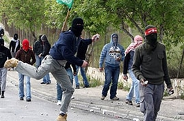 Palestinian youths throw stones at Israeli soldiers during clashes in the East Jerusalem neighborhood of Issawiya, 16 Mar 2010