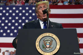 "U.S. President Donald Trump addresses supporters during a ""Make America Great Again"" rally in Southaven, Mississippi, Oct. 2, 2018."