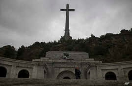 FILE - Tourists take a selfie outside of the Spanish former dictator General Francisco Franco's tomb at the Valle de los Caidos (Valley of the Fallen), near Madrid, May 10, 2016.