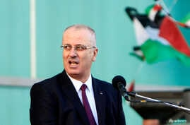 FILE - Palestinian Prime Minister Rami al-Hamdallah told the Al-Quds newspaper that the Palestinian government had expected to get $1.2 billion in foreign financial support and offers in the current financial year but had received only $640 million.