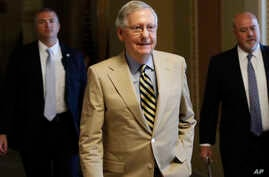 Senate Majority Leader Mitch McConnell of Kentucky walks from his office on Capitol Hill in Washington, Monday, June 26, 2017. Senate Republicans unveiled a revised health care bill in hopes of securing support from wavering GOP lawmakers, but McConn