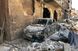 FILE - Rubble lines a street in Douma, the site of a suspected chemical weapons attack, near Damascus, Syria, April 16, 2018.