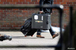 FILE - An inspector from the Organization for the Prohibition of Chemical Weapons (OPCW) arrives to begin work at the scene of the nerve agent attack on former Russian spy Sergei Skripal, in Salisbury, Britain, March 21, 2018. An OPCW team will begin