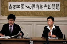 Opposition lawmakers Kiyomi Tsujimoto, right, and Masato Imai speak to reporters after visiting Osaka, western Japan, this week to investigate a scandal on a new elementary school in Tokyo, Feb. 23, 2017.