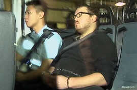 Rurik Jutting, 29, right, a British banker who has been charged with two counts of murder, sits in a police van as it arrives at a court in Hong Kong, Nov. 3, 2014.