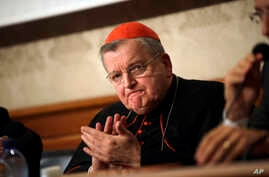 Cardinal Raymond Burke applauds during a press conference on the first anniversary of the death of Cardinal Carlo Caffarra, at the Italian Senate, Sept. 6, 2018.