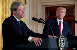 President Donald Trump watches as Italian Prime Minister Paolo Gentiloni pauses while answering a question during a news conference in the East Room of the White House in Washington, April 20, 2017.