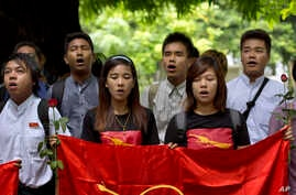 Myanmar students participate in a ceremony marking the 53rd anniversary of a 1962 student uprising at Yangon University, Myanmar, July 7, 2015